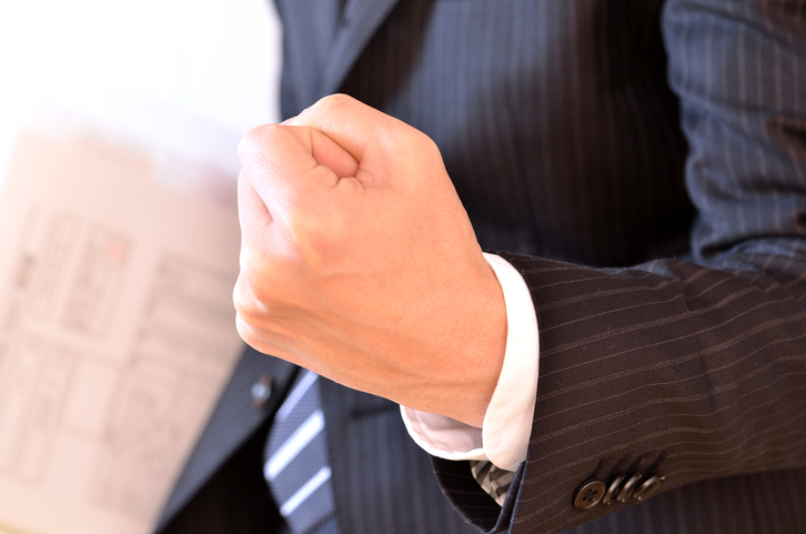This is a picture of a businessman's hand motion.