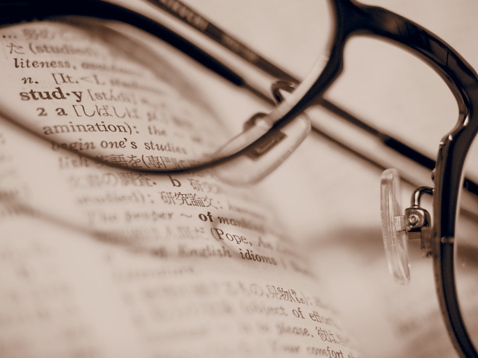 "The word ""Study"" in the English to Japanese dictionary over the eyeglasses"