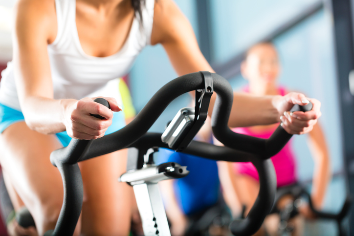 Young People - women and men - Spinning in the gym